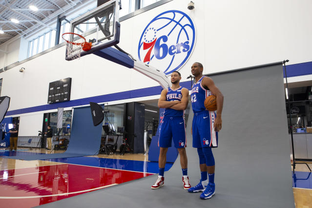 Ben Simmons (R) and Al Horford pose for a photo during media day on Monday. (Photo by Mitchell Leff/Getty Images)