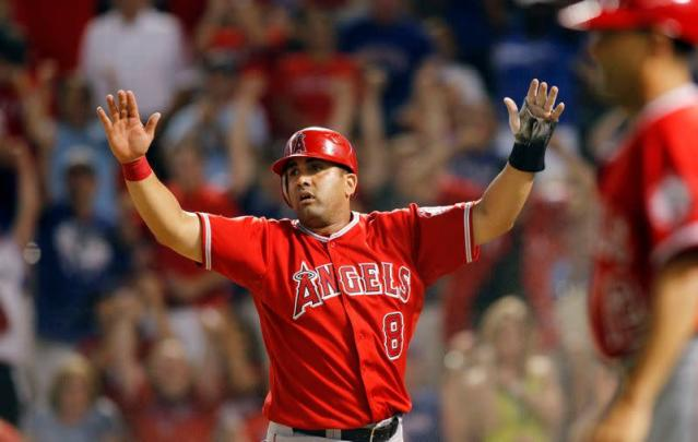 Los Angeles Angels' Morales reacts after being tagged out at home plate against the Texas Rangers in Arlington, Texas