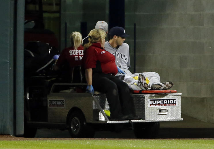 Former New York Yankees' outfielder Dustin Fowler is taken off the field after he was injured his MLB debut at Guaranteed Rate Field in Chicago. (AP)