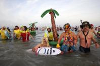People wearing costumes participate in a traditional New Year's Day swim in Malo-les-Bains, northern France January 1 2015. REUTERS/Pascal Rossignol (FRANCE - Tags: SOCIETY)