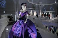 <p>Dita Von Teese and Marilyn Manson were anything but traditional, so for their 2005 wedding the burlesque dancer chose a custom violet silk dress by Vivienne Westwood.</p>