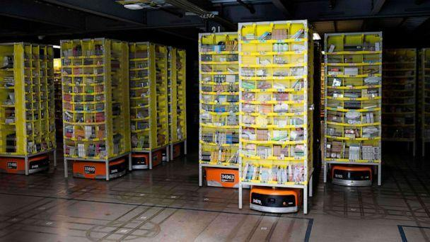 PHOTO: Hundreds of lawnmower-sized robots that move around shelving units in a closed field are seen during a tour of Amazon's Fulfillment Center, Sept. 21, 2018, in Kent, Wash. (Grant Hindsley/AFP/Getty Images)