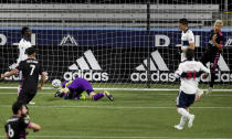 Seattle Sounders forward Raul Ruidiaz, right, celebrates after scoring as Vancouver Whitecaps goalkeeper Evan Bush sprawls on the pitch during the second half of an MLS soccer match in Portland, Ore., Tuesday, Oct. 27, 2020. (AP Photo/Steve Dykes)