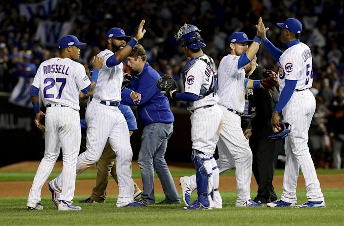 The Chicago Cubs celebrate after beating the San Francisco Giants at Wrigley Field on Oct. 8, 2016. (Photo: Jonathan Daniel/Getty Images)