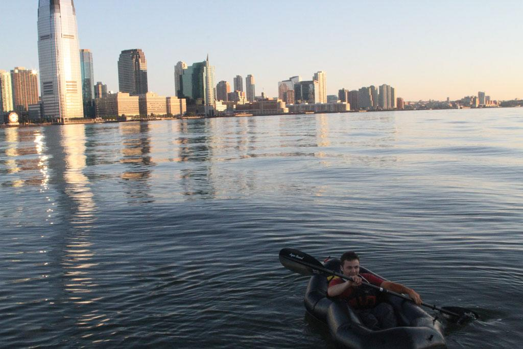 New York, NY, USA - Cameron Moore paddles the Hudson River.  He is prepping to escape in a nuclear meltdown.