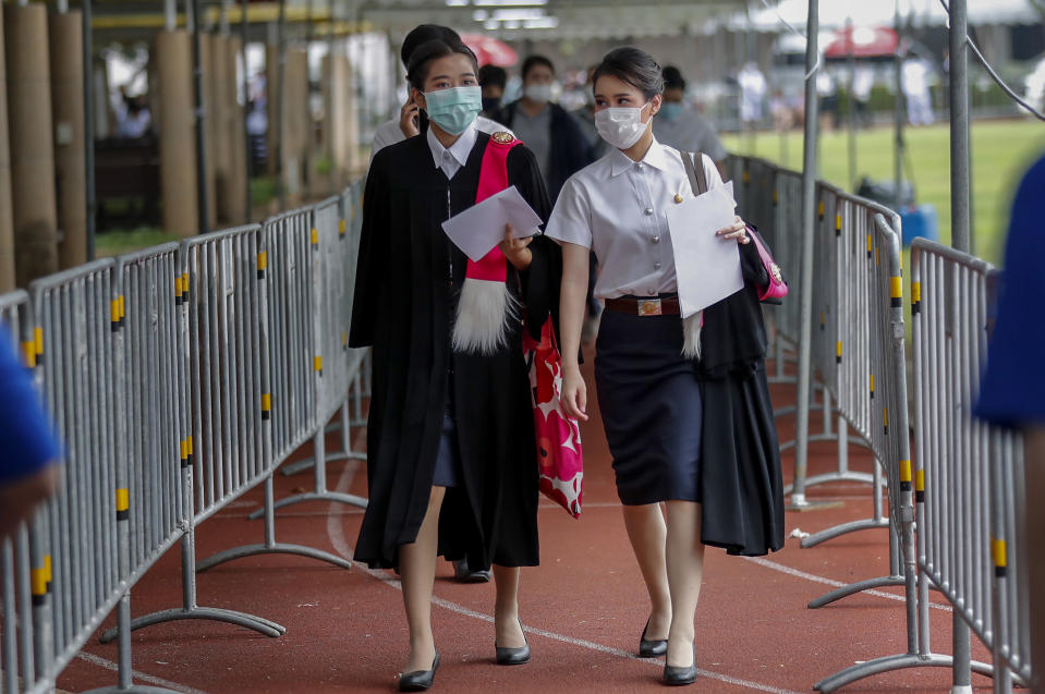 Students arrive for their graduation ceremony at the Thammasat University, Friday, Oct. 30, 2020, in Bangkok, Thailand. (AP Photo/Sakchai Lalit)