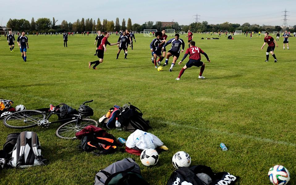 Players in action during Sunday morning Hackney & Leyton Football League matches at Hackney Marshes in London - Children's team sport completely wiped out by second Covid-19 lockdown despite continued PE classes - GETTY IMAGES