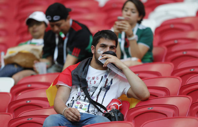 <p>A Germany fan sits dejected in the stands after his team lose the group F match between South Korea and Germany, at the 2018 soccer World Cup in the Kazan Arena in Kazan, Russia, Wednesday, June 27, 2018. South Korea won the match 2-0. (AP Photo/Frank Augstein) </p>