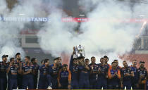 Indian players celebrate with the winners trophy after their win in the fifth Twenty20 cricket match between India and England at Narendra Modi Stadium in Ahmedabad, India, Saturday, March 20, 2021. India won the series 3-2. (AP Photo/Ajit Solanki)