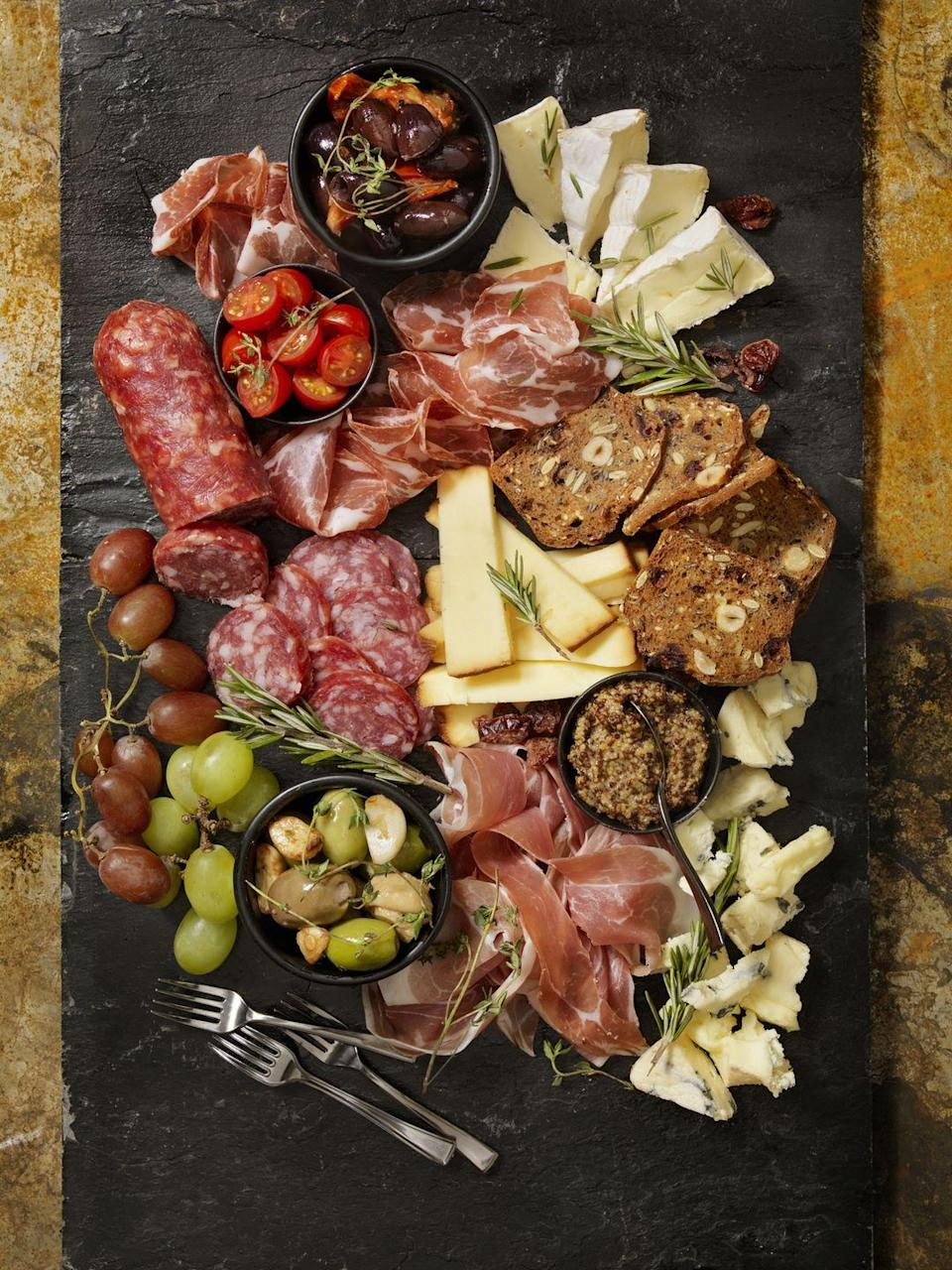 "<p>If you're not up to cooking, skip dinner and munch on delicious meats and cheeses instead. Design a gorgeous charcuterie board and serve with a bottle of wine for the best night in. (Or if dessert is more your thing, try a <a href=""https://www.thepioneerwoman.com/food-cooking/a34847673/hot-chocolate-board/"" rel=""nofollow noopener"" target=""_blank"" data-ylk=""slk:hot chocolate board"" class=""link rapid-noclick-resp"">hot chocolate board</a>!) </p><p><a class=""link rapid-noclick-resp"" href=""https://go.redirectingat.com?id=74968X1596630&url=https%3A%2F%2Fwww.walmart.com%2Fsearch%2F%3Fquery%3Dcheese%2Bboard&sref=https%3A%2F%2Fwww.thepioneerwoman.com%2Fholidays-celebrations%2Fg35118424%2Fthings-to-do-on-valentines-day%2F"" rel=""nofollow noopener"" target=""_blank"" data-ylk=""slk:SHOP CHEESE BOARDS"">SHOP CHEESE BOARDS</a></p>"