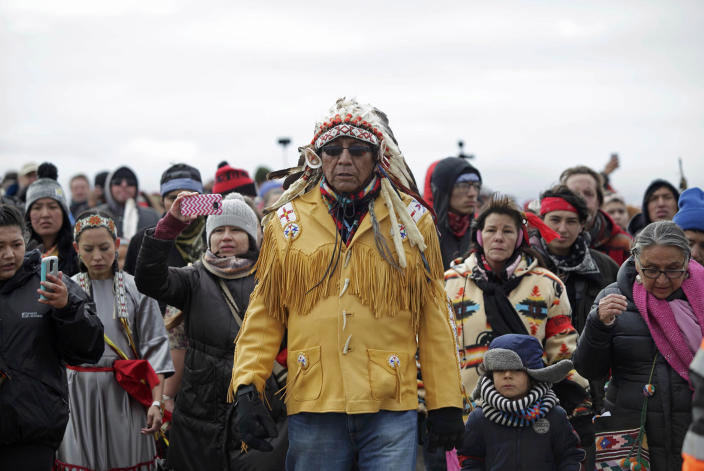 <p>Chief Arvol Looking Horse, spiritual leader of the Sioux Nation, leads his people to peacefully pray near a law enforcement barricade just outside of a Dakota Access pipeline construction site north of Cannon Ball, N.D., on Oct. 29, 2016. (Josh Morgan/Reuters) </p>