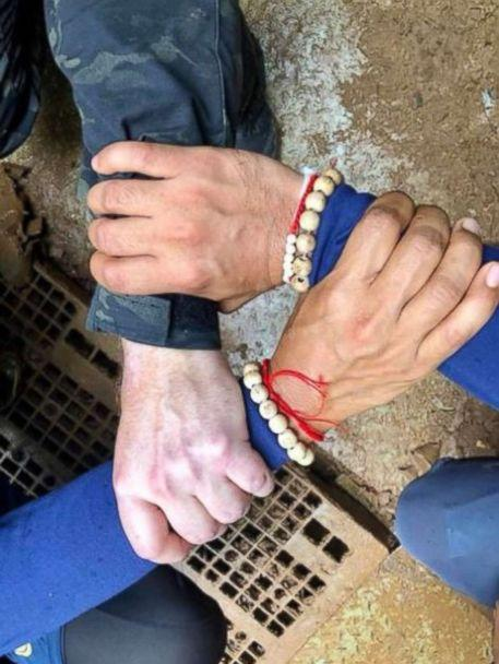 Rescuers in Thailand posted a photo of Thai and international divers linking hands before embarking on the rescue mission to save 12 boys and their soccer coach stuck in a cave, Sunday, July 8, 2018. (Royal Thai navy SEALs)