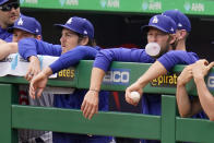 Los Angeles Dodgers' Clayton Kershaw, right, blows a bubble as he and Trevor Bauer, third from left, stand in the dugout during a baseball game against the Pittsburgh Pirates in Pittsburgh, Thursday, June 10, 2021. (AP Photo/Gene J. Puskar)