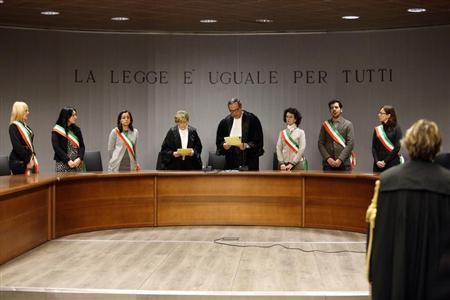 Judge Nencini reads the verdict during the retrial session of Amanda Knox and Raffaele Sollecito in Florence