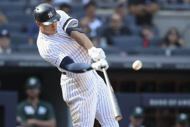 New York Yankees' Aaron Judge hits a solo home run during the eighth inning of a baseball game against the Oakland Athletics, Saturday, Aug. 31, 2019, in New York. (AP Photo/Mary Altaffer)