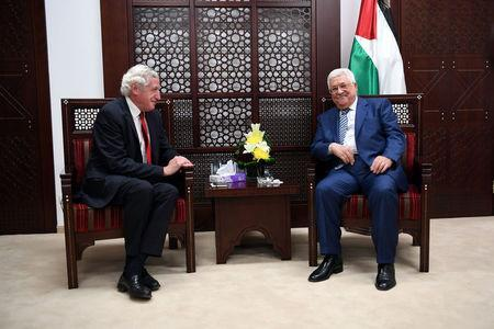 Palestinian President Mahmoud Abbas (R) meets with France's special envoy for the Middle East peace process, Pierre Vimont, in the West Bank city of Ramallah November 7, 2016. Palestinian President Office (PPO)/Handout via REUTERS