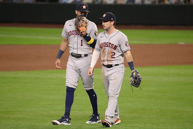 SEATTLE, WASHINGTON - SEPTEMBER 21: Carlos Correa #1 and Alex Bregman #2 of the Houston Astros have a conversation in the seventh inning against the Seattle Mariners at T-Mobile Park on September 21, 2020 in Seattle, Washington. (Photo by Abbie Parr/Getty Images)