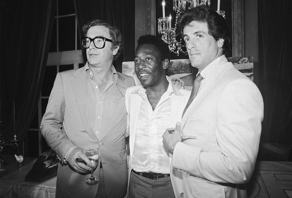 (L-R) Michael Caine, soccer great Pele, and Sylvester Stallone at a party celebrating the 7/16 opening of the film