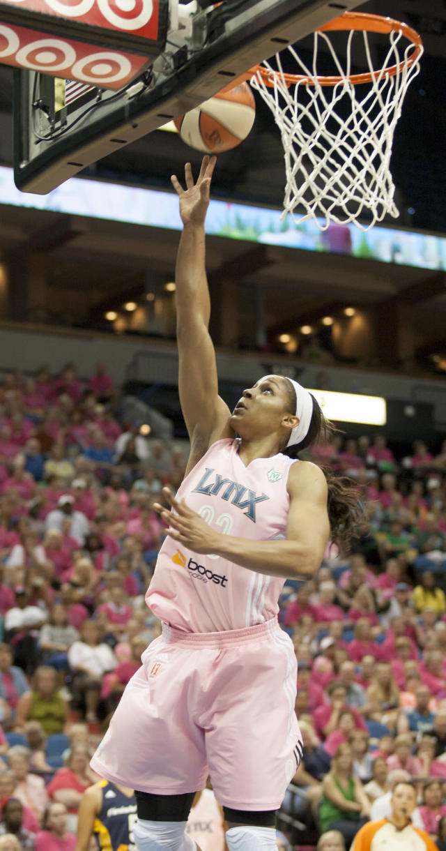 Minnesota Lynx forward Maya Moore (23) puts up two of her game-high 35 points during the first half of an WNBA basketball game against the Indiana Fever, Saturday, Aug. 24, 2013, in Minneapolis. (AP Photo/Paul Battaglia)