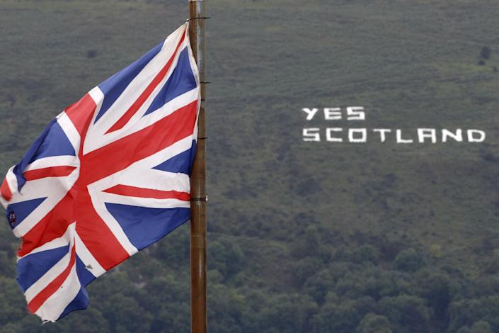 Republican writing supporting the Yes vote in the Scottish Referendum on a mountain in West Belfast, Northern Ireland, Monday, Sept. 8, 2014. Scotland is due to vote on September 18th in a referendum on Scottish independence and many people in Northern Ireland will be watching closely its outcome. (AP Photo/Peter Morrison)