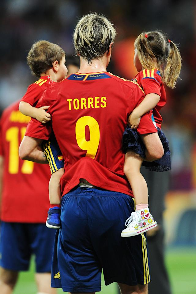 KIEV, UKRAINE - JULY 01: Fernando Torres of Spain holds his children Nora Torres (R) and Leo Torres (L) after the UEFA EURO 2012 final match between Spain and Italy at the Olympic Stadium on July 1, 2012 in Kiev, Ukraine. (Photo by Jasper Juinen/Getty Images)