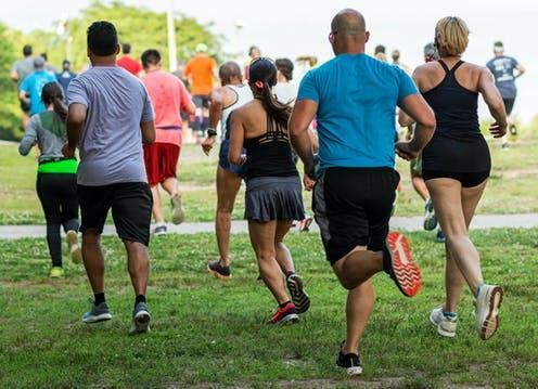 """<span class=""""caption"""">As the pandemic continues, many are looking for ways to replace parkrun safely.</span> <span class=""""attribution""""><a class=""""link rapid-noclick-resp"""" href=""""https://www.shutterstock.com/image-photo/runners-running-on-grass-away-camera-1441935023"""" rel=""""nofollow noopener"""" target=""""_blank"""" data-ylk=""""slk:WoodysPhotos/ Shutterstock"""">WoodysPhotos/ Shutterstock</a></span>"""
