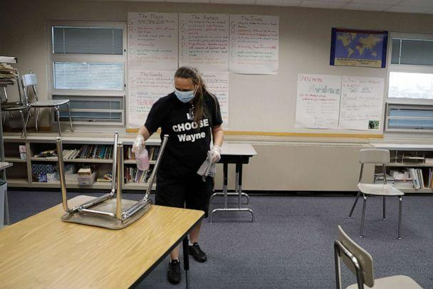 PHOTO: Diane Tomey cleans a classroom at McClelland Elementary School, June 22, 2020, in Indianapolis. (Darron Cummings/AP, FILE)