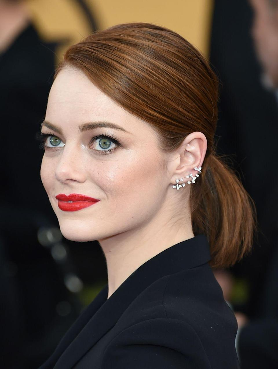 <p>The specs of diamond earrings climbing up her lobes makes Emma's ethereal beauty look even more like she just walked out of a fairytale. </p>
