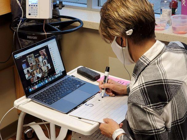 PHOTO: Kelly Klein teaches her kindergarten students virtually while undergoing a chemotherapy treatment at M Health Fairview Lakes Medical Center in Minnesota on Dec. 23, 2020. (Edwin Visalden/M Health Fairview )
