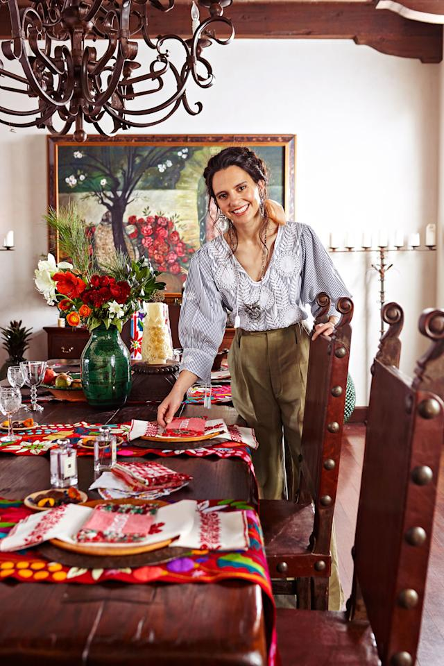 """<p>""""One of the things I love most about the holidays in Mexico is that there are a lot of colors, and they aren't just red and green,"""" says Lynch. She uses four of her own runners, arranged like stripes across the table, to ground the place settings. Craftswomen in Zinacantán, Mexico, embroider the table runners by hand. </p>"""
