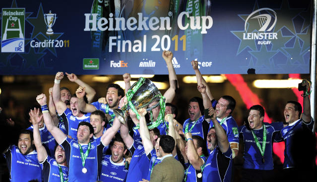 Leinster players celebrate with the trophy after winning their Heineken Cup Final match against Northampton Saints at the Millennium Stadium, Cardiff, Wales, on May 21, 2011. AFP PHOTO/GLYN KIRK NOT FOR MARKETING OR ADVERTISING USE/RESTRICTED TO EDITORIAL USE (Photo credit should read GLYN KIRK/AFP/Getty Images)