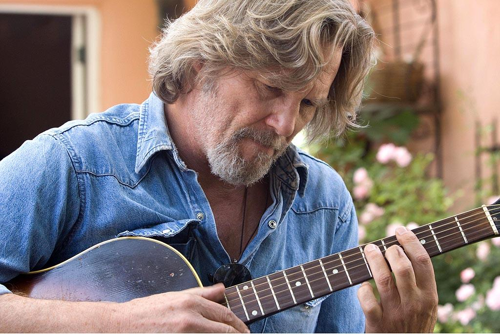 """Jeff Bridges' performance in """"Crazy Heart"""" earned him his sixth Academy Award nomination and his first win for Best Actor. In the 2009 film, the veteran actor plays a down-and-out singer-songwriter, Bad Blake, whose career and life gets a reboot after he falls in love with a journalist, played by Maggie Gyllenhaal, assigned to interview him. """"When I first got the script, there wasn't any music attached to it, so I took a passer on it,"""" Bridges has said. """"When I found out from my good buddy, [singer/songwriter] T-Bone Burnett, that he was going to do it if I was going to do it, then that filled in that empty, missing piece. When he got involved, I knew the music was going to be top notch, and that got me to the party really quick.""""<br><br><a target=""""_blank"""" href=""""http://www.amazon.com/Crazy-Heart-Scott-Cooper/dp/B0039UT3LK"""">Buy """"Crazy Heart"""" on DVD</a>"""