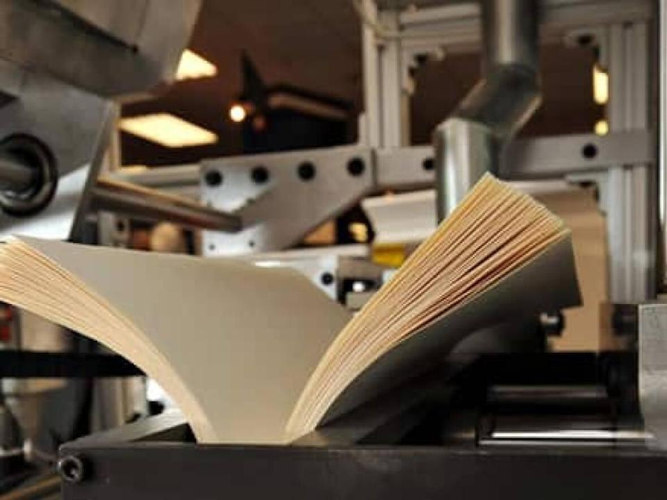 Local publishers say a shortage of book printing supplies and access to printing plants are leading to new releases being delayed. (Leon Neal/AFP/Getty Images - image credit)