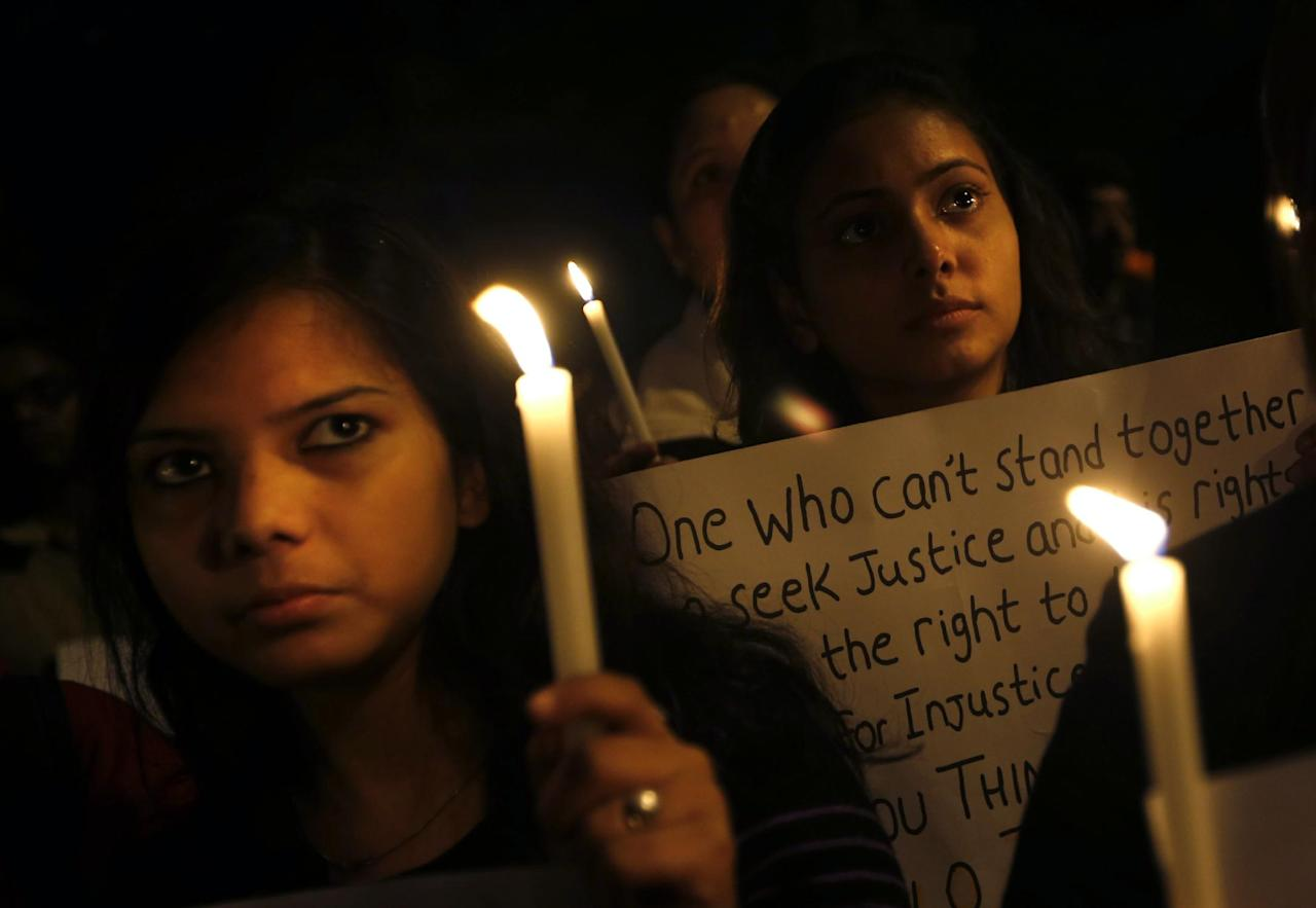 Indian students participate in a candlelight vigil to mark the passing of a month since a gang rape of a 23-year-old student in a bus, in New Delhi, India, Wednesday, Jan. 16, 2013. The bus rape has drawn protests and intense media attention. Rapes have become front-page news nearly every day across the country, with demands that police do more to protect women and that the courts treat sexual violence seriously.in New Delhi, India , Wednesday, Jan. 16, 2013. (AP Photo/Saurabh Das)