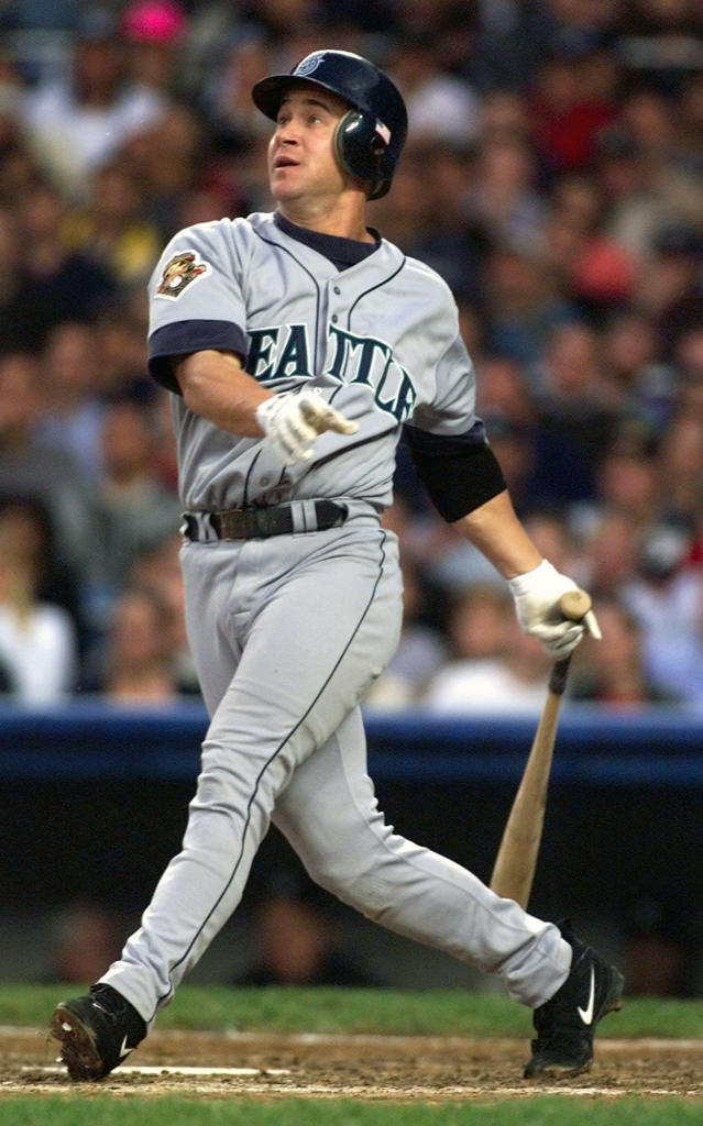 FILE - In this Oct. 20, 2001, file photo, Seattle Mariners' Bret Boone watches his two-RBI single in the fifth inning against the New York Yankees during Game 3 of the American League Championship at Yankee Stadium in New York. Princeton Tigers' Jake Boone is trying to put himself in position to make his the first four-generation major league family. His great-grandfather, Ray, was a two-time All-Star infielder from 1948-60. His grandfather, Bob, was a four-time All-Star catcher from 1972-90, then managed Kansas City from 1995-97 and Cincinnati from 2001-03. His father Bret, was a three-time All-Star second baseman in a big league career from 1992-05. And uncle Aaron is managing the New York Yankees. (AP Photo/Rusty Kennedy, File)