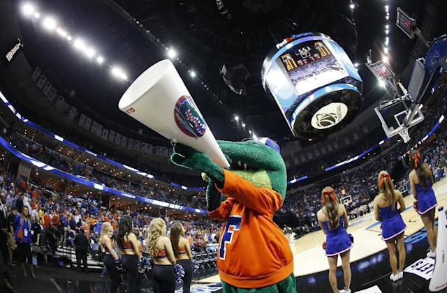 The Florida mascot cheers before the first half in a regional semifinal game against UCLA at the NCAA college basketball tournament, Thursday, March 27, 2014, in Memphis, Tenn. (AP Photo/John Bazemore)