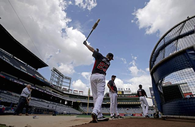 Atlanta Braves third baseman Chris Johnson (23) takes some practice swings before batting practice Wednesday, Oct. 2, 2013, in Atlanta. Game 1 of baseball's NL division series between the Braves and the Los Angeles Dodgers is scheduled for Thursday. (AP Photo/Atlanta Journal Constitution, Jason Getz)