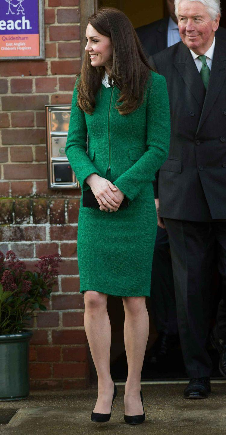 <p>The Duchess wears an emerald green tweed skirt by Hobbs and matching jacket with black clutch by Mulberry and pumps by Gianvito Rossi during her visit to East Anglia's Children's Hospices in Norfolk, England.</p>