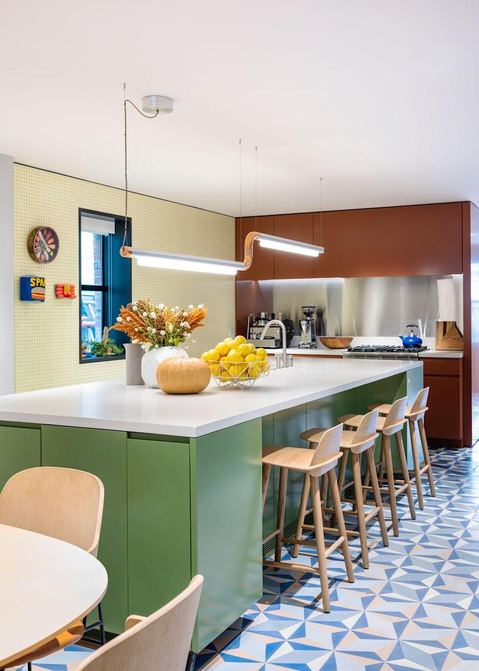 """<p>The kitchen in this <a href=""""https://elledecoration.co.uk/houses/a36926452/mkca-home-new-york/"""" rel=""""nofollow noopener"""" target=""""_blank"""" data-ylk=""""slk:Brooklyn home"""" class=""""link rapid-noclick-resp"""">Brooklyn home</a> by architecture studio MKCA uses bold tones to create practical zones – muted terracotta red marks out the practical prep area, while a vivid green on the island makes for an inviting sociable space. Meanwhile, a colourful floor with tiles from Cement Tile Shop maintains a sense of connection and flow. <a href=""""https://www.cementtileshop.com/SFNT.html"""" rel=""""nofollow noopener"""" target=""""_blank"""" data-ylk=""""slk:cementtileshop.com"""" class=""""link rapid-noclick-resp"""">cementtileshop.com</a></p>"""