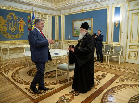 Ukraine's President Petro Poroshenko (L) meets with Patriarch Filaret, head of the Ukrainian Orthodox Church of the Kiev Patriarchate, in Kiev, Ukraine October 11, 2018. Mykhailo Markiv/Ukrainian Presidential Press Service/Handout via REUTERS