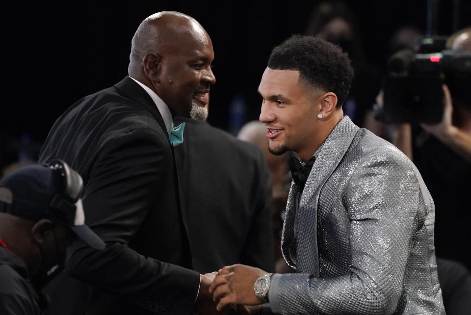 Jalen Suggs is congratulated by supporters after being selected fifth overall by the Orlando Magic during the NBA basketball draft, Thursday, July 29, 2021, in New York. (AP Photo/Corey Sipkin)