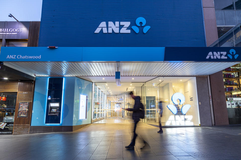Sydney, Australia - September 12, 2019:  A pedestrian walks past a retail branch of Australia and New Zealand Banking Group (ANZ) in Chatswood, Australia on September 12, 2019.  ANZ is currently the sixth largest Australian company and fourth largest financial institution listed on the Australian Securities Exchange, as of September 2019. The bank is one of the