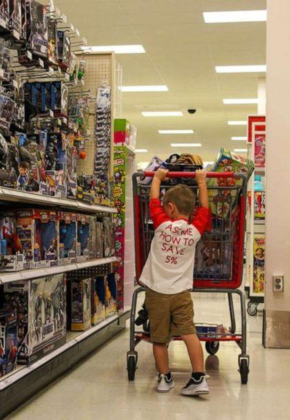 PHOTO: Cooper finished his birthday by using his 'employee discount' to shop for toys at the store. (Hannah Rickman/Momgical Photography)