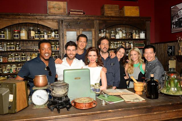 "Russel Hornsby, David Giuntoli, Sasha Roiz, Bitsie Tulloch, Silas Weir Mitchell, Bree Tuner, Claire Coffee, and Reggie Lee inside NBC's ""Grimm"" Exotic Tea and Spice Shop installation at San Diego Comic-Con."