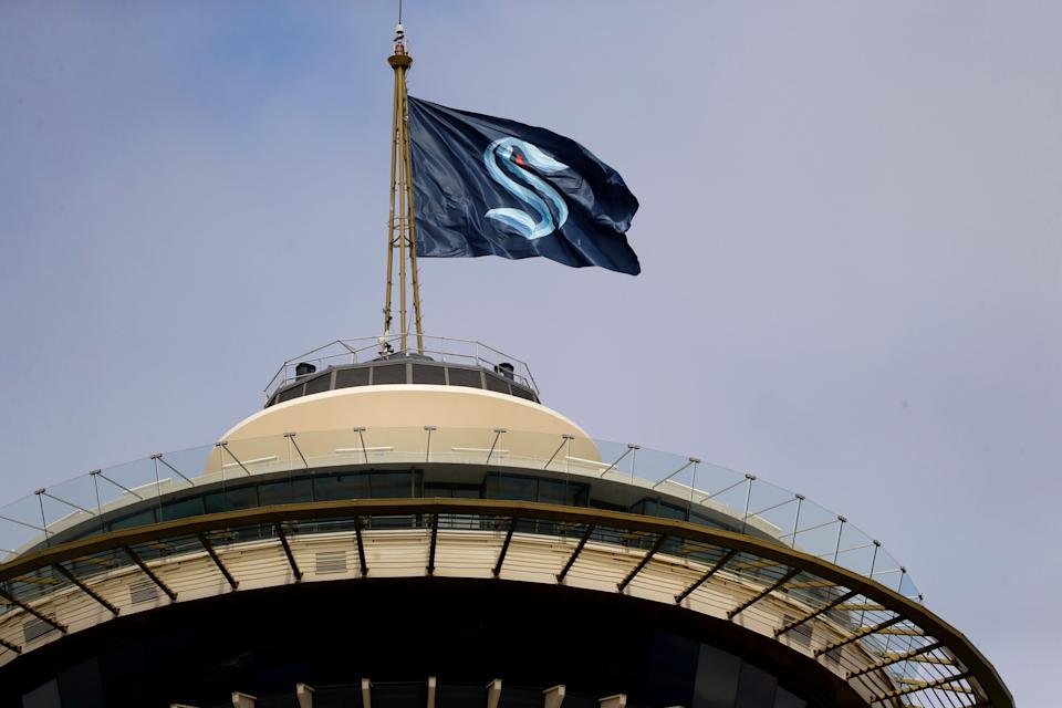 A flag with the new logo for the Seattle Kraken, flies atop the iconic Space Needle Thursday, July 23, 2020, in Seattle.