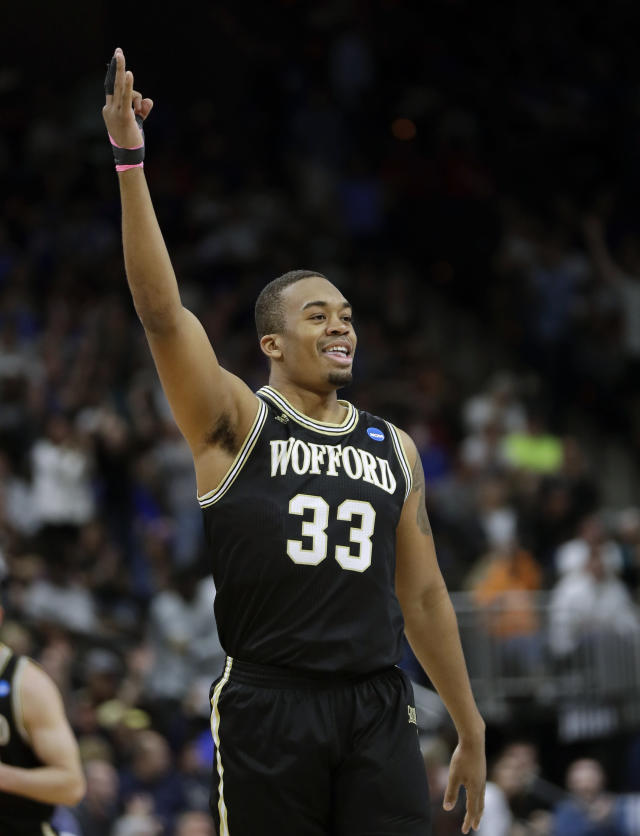 Wofford's Cameron Jackson (33) hold up 3-fingers after sinking a 3-point shot during the first half of a second-round game in the NCAA mens college basketball tournament in Jacksonville, Fla., Saturday, March 23, 2019. (AP Photo/John Raoux)