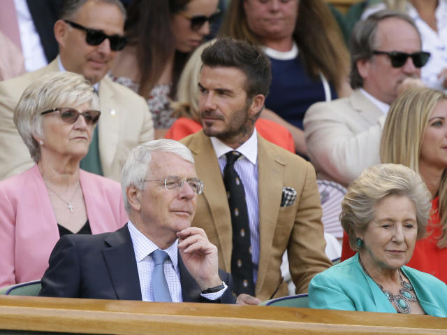 Former British Prime Minister John Major, left, his wife Norma, former British footballer David Beckham, center top, sit in the Royal Box on Centre Court on day ten of the Wimbledon Tennis Championships in London, Thursday, July 11, 2019. (AP Photo/Tim Ireland)