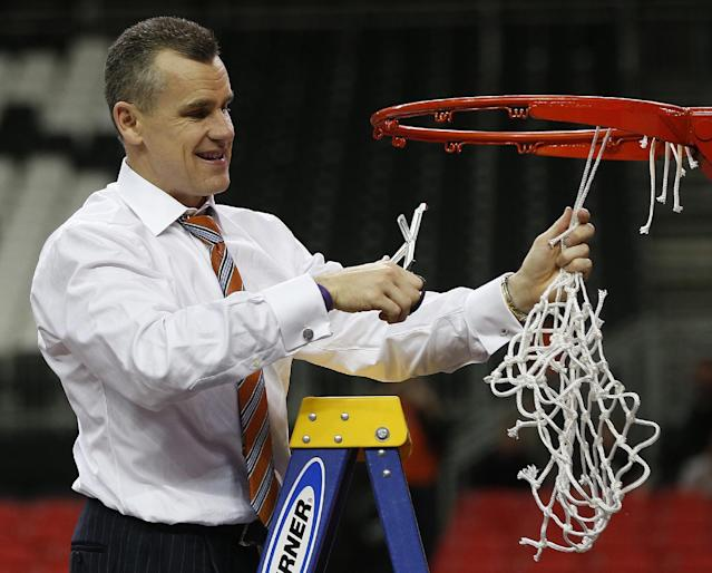 Florida head coach Billy Donovan takes the net after the second half of an NCAA college basketball game against Kentucky in the Championship round of the Southeastern Conference men's tournament, Sunday, March 16, 2014, in Atlanta. Florida won 61-60. (AP Photo/John Bazemore)