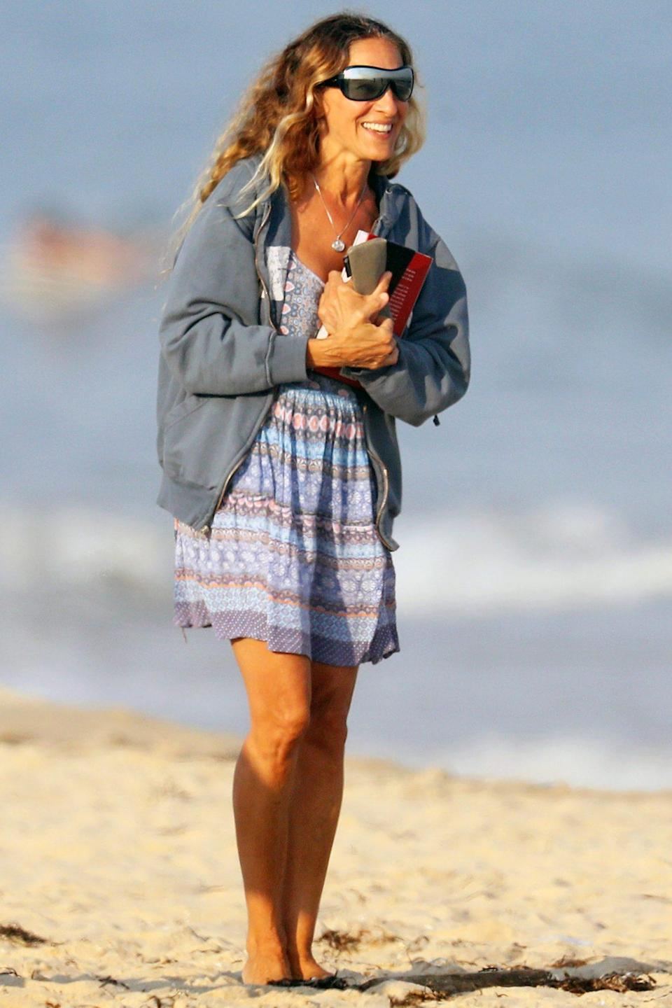 <p>Sarah Jessica Parker soaks up the sun and gets in some reading while on the beach in The Hamptons, New York, on Wednesday.</p>