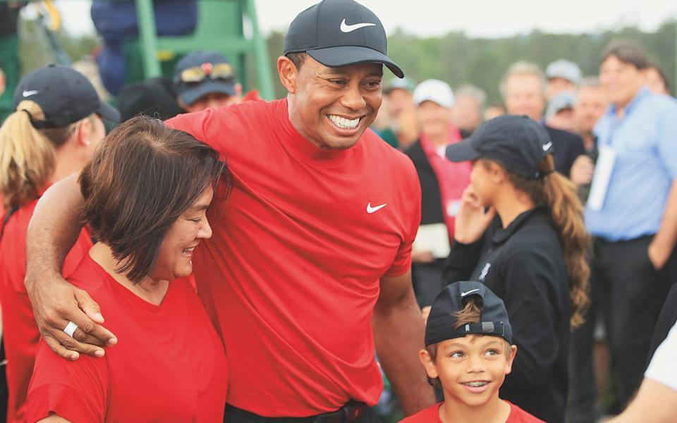 Celebrating his 2019 Masters victory with his mother and son - Getty Images